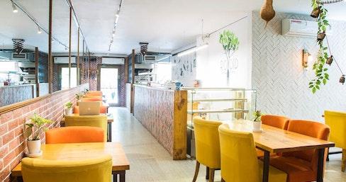 Cafe Untold - myHQ Workspace, New Delhi | coworkspace.com